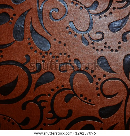 Leather texture woth abstract ornaments close up - stock photo