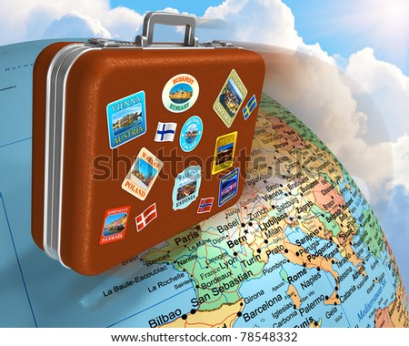 Leather travel suitcase with labels flying around the Earth globe - stock photo