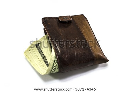 Leather wallet full of money on white background - stock photo
