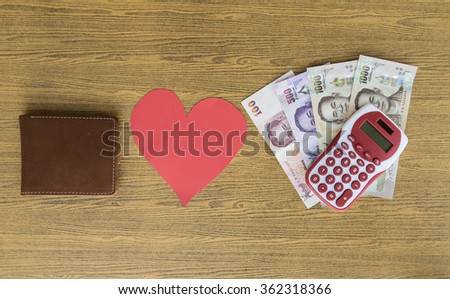 Leather Wallet loves money's plan and bills - stock photo