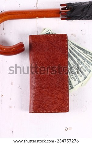 Leather wallet,umbrella, money - stock photo