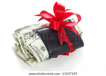 Leather wallet with some dollars inside wrapped in red bow