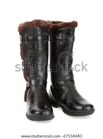 Leather winter boots on a white background it is isolated.