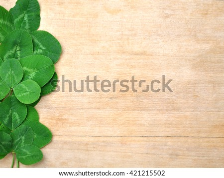 leaves clover on wooden background - stock photo