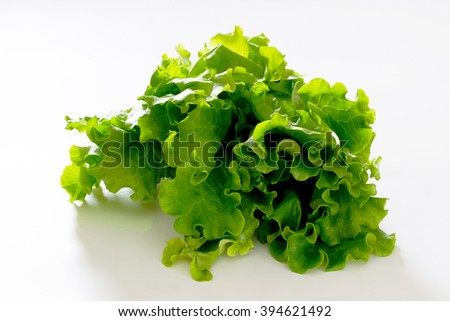 Leaves of green salad on white background, selective focus.