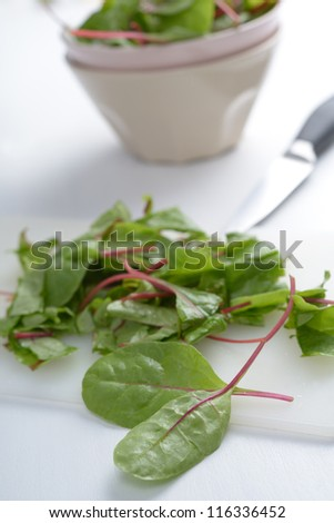 Leaves of red chard on a cutting board