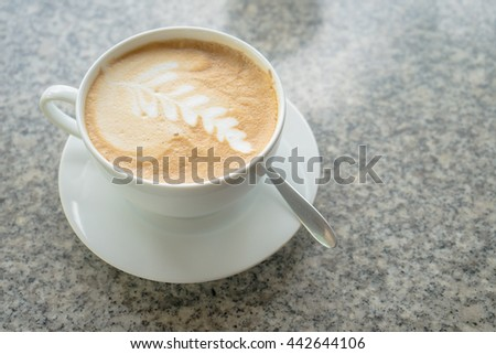 Leaves on coffee  foam