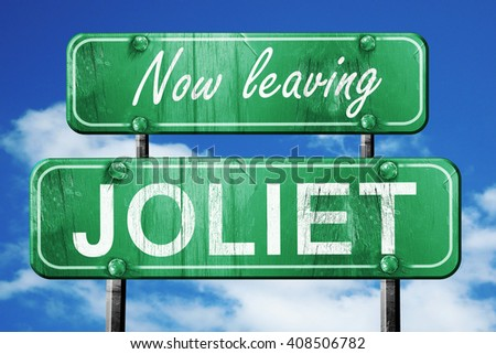 Leaving joliet, green vintage road sign with rough lettering