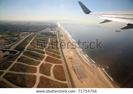Leaving Los Angeles airport in an airplane aka LAX and flying over the pacific ocean on the way to Maui Hawaii - stock photo
