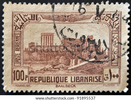 LEBANON - CIRCA 1930: A stamp printed by Lebanon, shows Ruins of Bacchus Temple, Baalbek, circa 1930 - stock photo