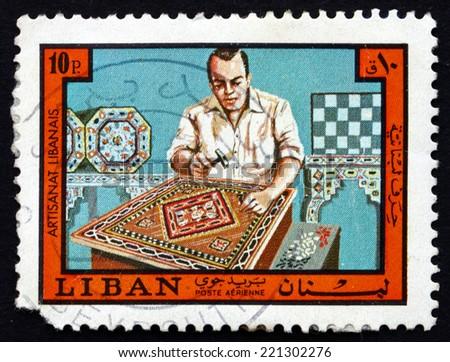 LEBANON - CIRCA 1973: a stamp printed in the Lebanon shows Inlay Worker, Lebanese Handicraft, circa 1973 - stock photo