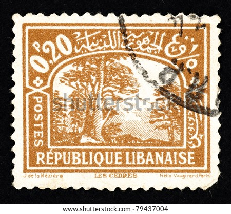 LEBANON - CIRCA 1948: Stamp printed in Lebanon showing a landscape with cedar trees and mountain, circa 1948.