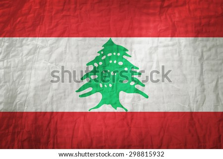 Lebanon flag painted on a Fabric creases,retro vintage style