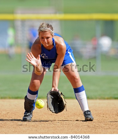 LEBANON, PA - MAY 9: Cedar Crest High School softball player Sarah Lebo fields a grounder on defense during a game against Manheim Township May 9, 2011 in Lebanon, PA - stock photo