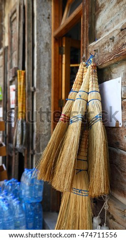 Lebanon- traditional straw brooms on sale in the village market