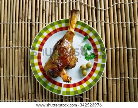 Lechazo asado - Spanish roast lamb - stock photo