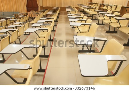 Lecture chairs in a class room with stair path