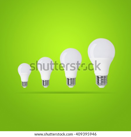 led bulb on green background
