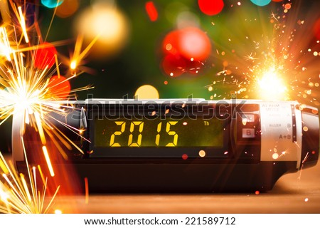 Led display of alarm clock with 2015 new year - stock photo