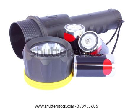 LED flashlight and battery isolated on white background - stock photo