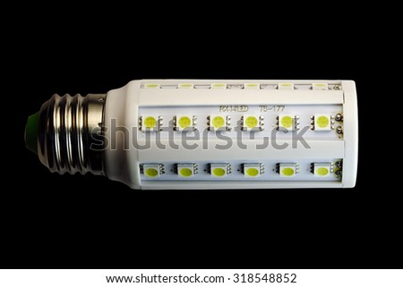 LED lamp isolated on a black  background  with clipping path. Closeup with no shadows.  8 watts.  Energy-saving technology. The lamp with a conventional socket.  - stock photo