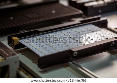 LED light production. Image of circuit board - stock photo