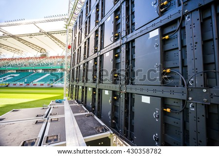 Led screen installed on the stadium before multimedia event - stock photo