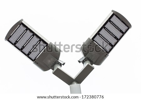 LED street lamps post on white background - stock photo