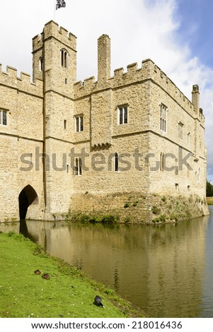 Leeds castle detail, Maidstone, England detail of the medieval castle reflecting in its moat, shot in bright light under a cloudy sky  - stock photo
