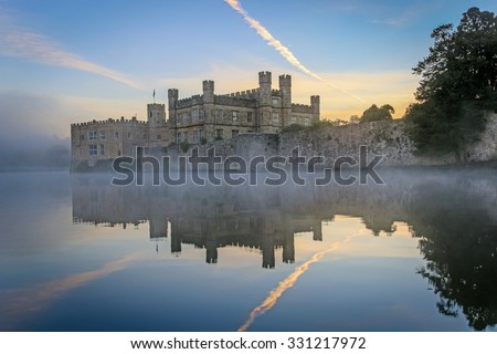 Leeds Castle, Kent, England, at dawn, with mist on the lake. - stock photo