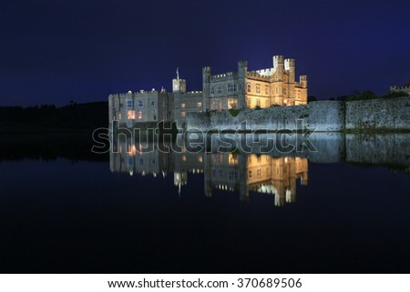 Leeds Castle, Kent, England, at night, reflected in the moat.  - stock photo