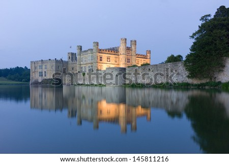 Leeds Castle mirrored in surrounding Water - stock photo