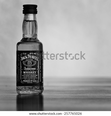 LEEDS - FEBRUARY 27: Jack Daniels whiskey bottle, image processed in black and white. February 27, 2015 in Leeds, UK. - stock photo