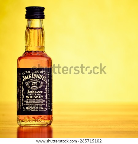 LEEDS - FEBRUARY 27: Jack Daniels whiskey on a bright yellow background. February 27, 2015 in Leeds, UK. - stock photo