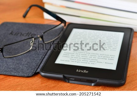 LEEDS - JULY 16: Amazon Kindle paper white e book reader. July 16, 2014 in Leeds, UK. - stock photo