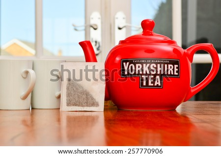 LEEDS - MARCH 04 : Yorkshire Tea teapot teabags and teacups, 2015 in Leeds, UK. - stock photo