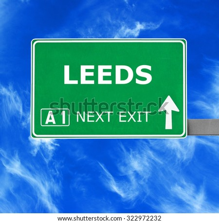 LEEDS road sign against clear blue sky