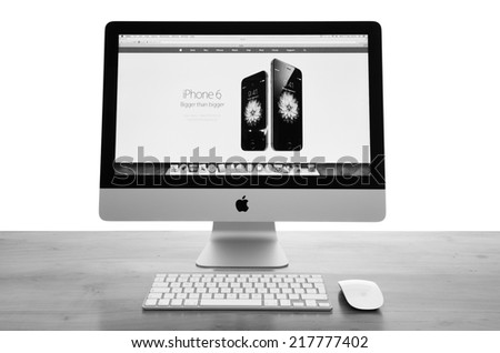 LEEDS - SEPTEMBER 17: Apple iMac with the new iPhone 6 displayed on the screen. Image processed in black and white. September 17, 2014 in Leeds Yorkshire, UK. - stock photo