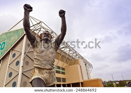 LEEDS, UK - APRIL 27, 2014: A statue of former Leeds' captain Billy Bremner at  Elland Road stadium, home of Leeds United Football Club since 1919 following the disbanding of Leeds City F.C. - stock photo