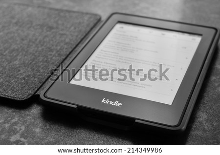 LEEDS, UK - JULY 16: Amazon Kindle paper white e book reader, image processed in black and white. July 16, 2014 in Leeds, UK. - stock photo