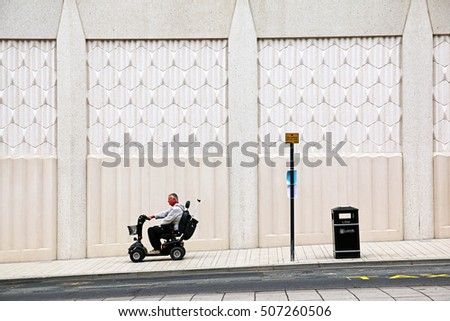 LEEDS, UK - OCTOBER 30, 2016: Man on a mobility scooter outside the Victoria Gate shopping centre. Victoria Gate is a £165 million retail development which opened on 21 October 2016