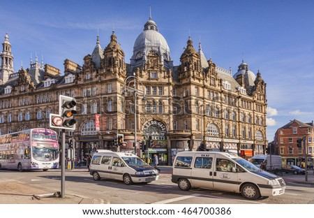 Leeds, West Yorkshire, England: 10 February 2016 - Taxi cabs and a bus passing the Leeds City Markets, West Yorkshire, England, UK
