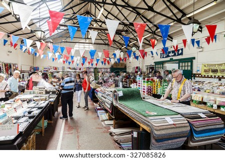 Leek, Staffordshire, England - August 12, 2015: Leek Butter and Trestle Market a typical traditional British Victorian indoor market - stock photo