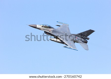 LEEUWARDEN, NETHERLANDS - APRIL 15, 2015: A Netherlands Air Force F-16 flyby during the exercise Frisian Flag. The exercise is considered one of the most important NATO training events this year. - stock photo