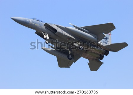 LEEUWARDEN, NETHERLANDS - APRIL 15, 2015: US Air Force F-15 Eagle landing during the exercise Frisian Flag. The exercise is considered one of the most important NATO training events this year. - stock photo