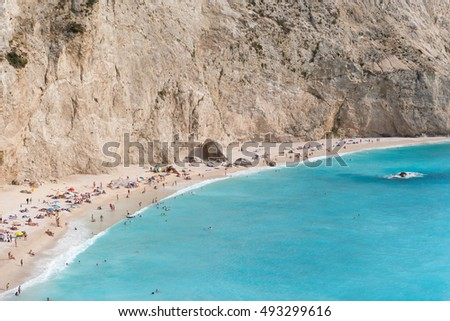 Lefkada, Greece - September 07, 2016: Overcrowded sandy beach on Lefkada island, Greece.