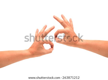 left and right hand holding for Okay symbol isolated on white. - stock photo