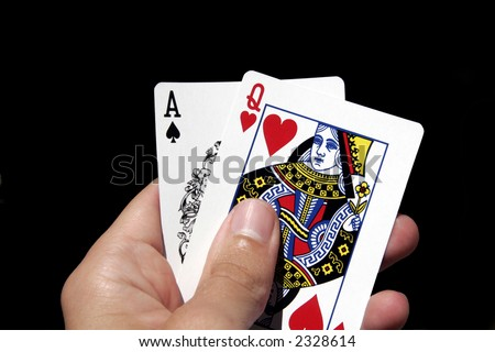 Left Hand Holding Gambling Cards - Ace Of Spades, Queen Of Hearts - stock photo