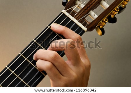 Left Hand Position Basic Chord of Classic Guitar / Bmaj7 Chord - stock photo