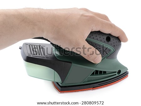 Left handed carpenter's hand sanding with electrical sander isolated on white background.   - stock photo